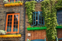 facade detail in Covent Garden with colorful houses. It contains several health food cafes and values driven retailers.