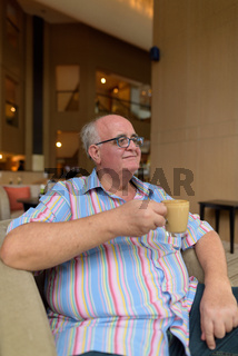 Overweight senior tourist man exploring around the city of Bangk