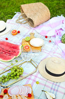 Picnic background with white wine on green grass