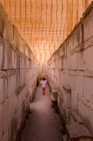 Lonely young boy walking in a corridor