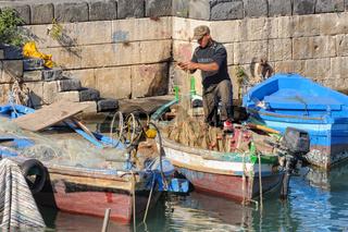 Fisherman in the dock - Siracusa