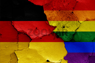 flags of Germany and LGBT painted on cracked wall