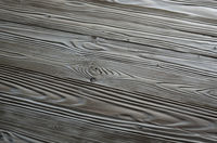 Weathered pine wood planks background with grained surface. Place for text