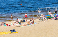 People rest at the river sand beach