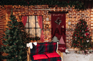 Decorated christmas studio. Background of brick wall.