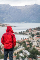 Man in red jacket looking at Kotor from above