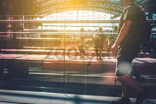 Travel concept, people with luggage walking on train station platform - abstract