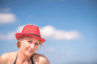 Caucasian woman with a red wicker hat