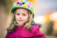 Young girl wearing cycle helmet