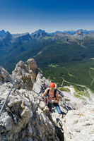 young attractive brunette female mountain climber in the Dolomites of Italy