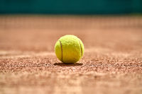 Tennis ball on ground