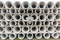 Stack of concrete sewer pipes at factory