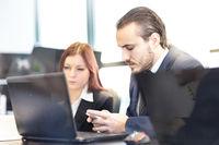 Business people in modern office.