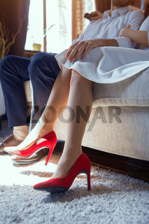 Woman wearing red shoes.