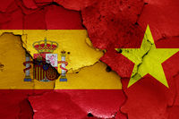 flags of Spain and Vietnam painted on cracked wall