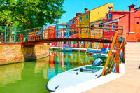 Bridge and colorful houses by canal in Burano