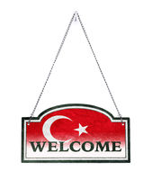 Turkey welcomes you! Old metal sign isolated