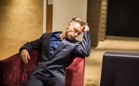Handsome elegant man sitting in hotel lounge