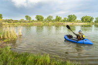 paddling a packraft on a calm lake