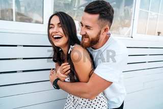 Handsome bearded man hugging his beautiful girl
