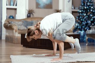 Mature woman balances on her arms. Yoga