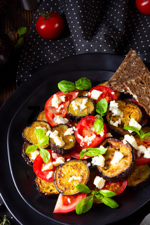 Eggplant grilled with aromatic feta cheese and tomatoes