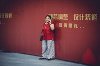 Woman with a smartphone in the Chengdu city