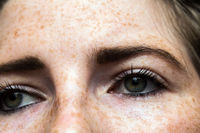 Eyes nose woman portrait with freckles close-up healthy skin