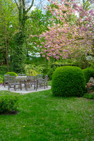 beautiful garden with table and chairs