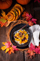 gratinated vegetarian pumpkin with barley groats, plums and thyme