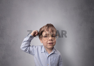 Adorable little boy in front of an empty wall