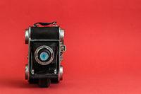 Decorative Nostalgic Camera Figurine on Red Background