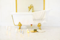 Bathroom with candles, book, glass of champagne