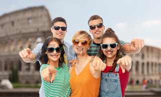 friends in shades pointing at you over coliseum