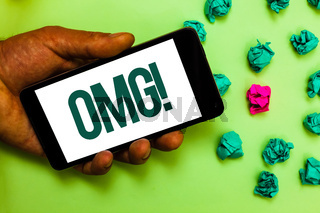 Conceptual hand writing showing Omg Motivational Call. Business photo text Oh my good abbreviation Modern Astonishment expression Text message smart screen mobile handset crumpled small balls.