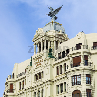 Old house with a sculpture on top. Scene in Valencia, Spain.