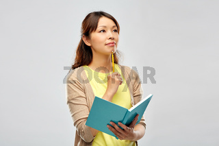 asian student woman with diary and pencil