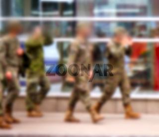 anonymous military men in uniform