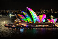Sydney Opera House illuminated with beautiful vibrant multi colour imagery at night