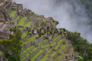Beautiful wallpaper of Machu Picchu and clouds on the Andes. No people.