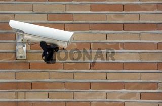 Surveillance camera brick wall
