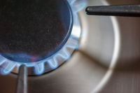 Gas flame from a stove in a kitchen