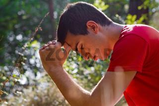 Man Praying in Nature