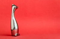 Metal Coated Cat Shape figurine on Red Background
