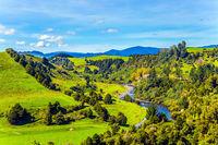 Narrow river between wooded hills