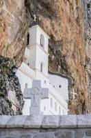 white cross and Ostrog Orthodox monastery