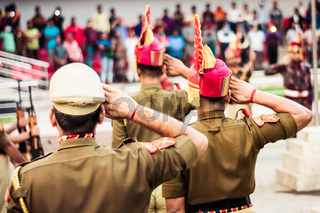 Portrait of an unrecognizable indian policeman saluting each other.