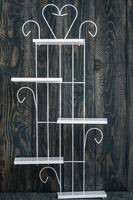 Vintage White Wrought Iron Shelf on Blue