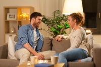 happy couple talking at home in evening