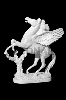 statue of a horse with wings on a black background